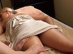 Blonde babe fingers her pussy after massage